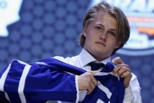 Image from: http://www.thestar.com/content/dam/thestar/sports/leafs/2014/06/27/nhl_draft_maple_leafs_pick_william_nylander/nylander_jersey.jpg.size.xxlarge.promo.jpg