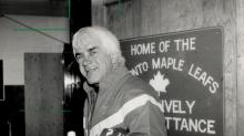 Why the smile?: Coach John Brophy of the Maple Leafs gave a broad smile yesterday as he left the Gardens, likely because owner Harold Ballard said he won't be fired at least for the next three weeks. Leafs have lost four games in a row but they are hindered by injuries.
