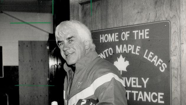 Why the smile?: Coach John Brophy of the Maple Leafs gave a broad smile yesterday as he left the Gar